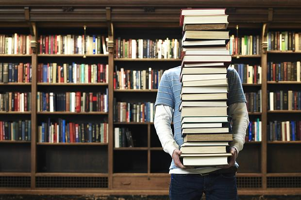 Image result for carrying a lot of books